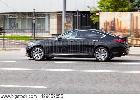 Genesis G80 On The Street In Motion. Side View Of A Premium Korean Car, Luxury Black Sedan. Moscow,