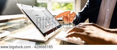 Online Digital Invoice Document. Accountant Checking Bill