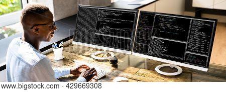 African American Coder Using Computer At Desk. Web Developer