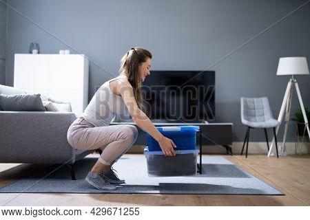 Correct Box Lifting Posture. Heavy Weight Lift