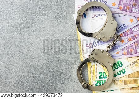 Euro banknotes and handcuffs. Top view.
