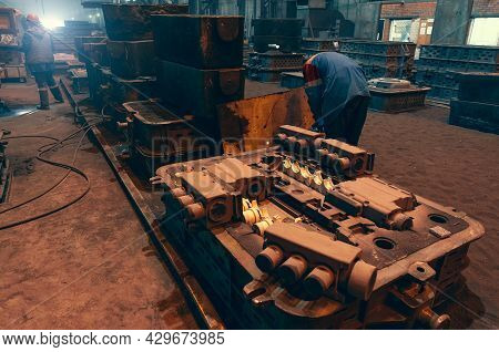 Molds For Casting In A Metallurgical Plant Close-up. Foundry Workshop Inside With Industrial Equipme