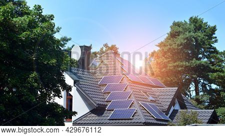 Solar System Panels On A Single-family House With Blue Sky