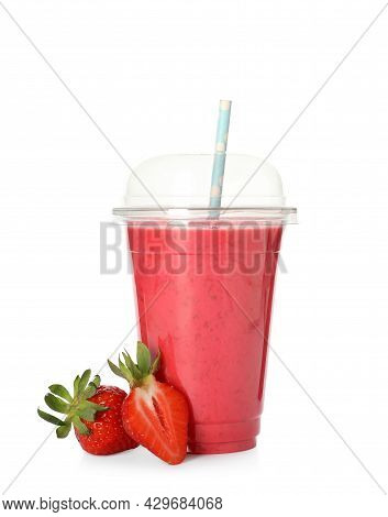 Delicious Smoothie With Straw In Plastic Cup And Fresh Strawberries On White Background