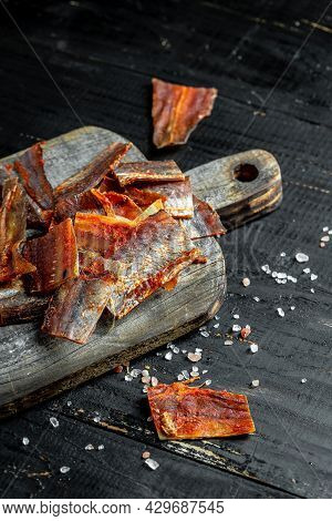 Dried Catfish Fillet On Wooden Background. Snack For Beer Dried Smelts. Banner, Menu, Recipe Place F