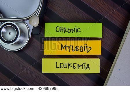 Chronic Myleoid Leukemia Write On Sticky Notes Isolated On Wooden Table.