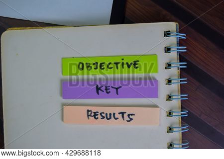 Objective Key Results Write On Sticky Notes Isolated On Wooden Table.