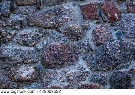 A Fragment Of Granite Masonry Taken Close-up In Daylight.