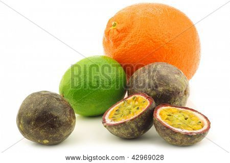 minneola,lime fruit and cut passion fruit on a white background poster