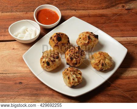 Veg Tandoori Momo. Nepalese Traditional Dish Momo Stuffed With Vegetables And Then Cooked And Served