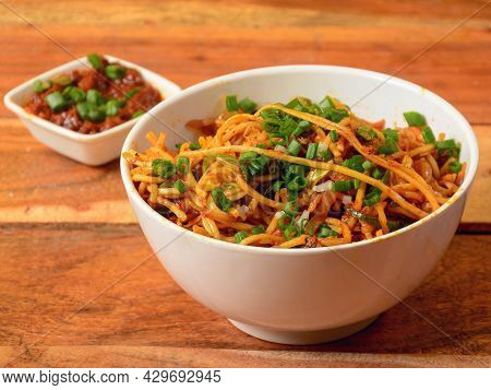 Veg Noodles A Popular Indo-chinese Dish Made With Noodles And Vegetables, Served Over A Rustic Woode