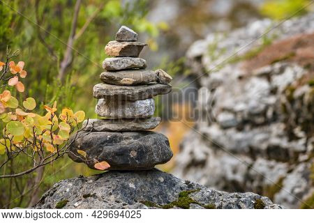 Balance stones on the rock in autumn forest. Concept of balance and harmony