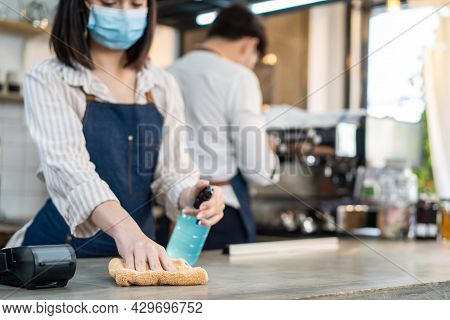 Cafe Waiter Wear Mask, Clean Restaurant With Sanitizer To Open Store. Asian Attrctive Young Couple D