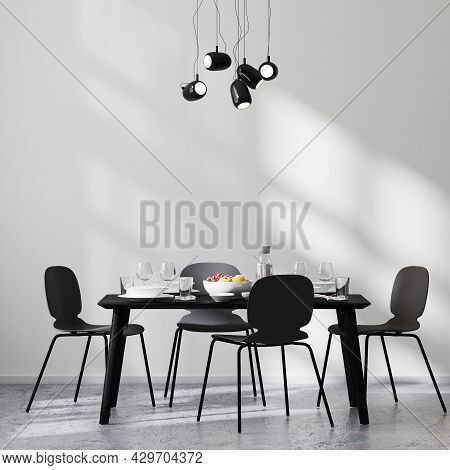 Modern Dining Room Interior With Black Table And Chairs And White Wall With Sunbeams, Concrete Floor