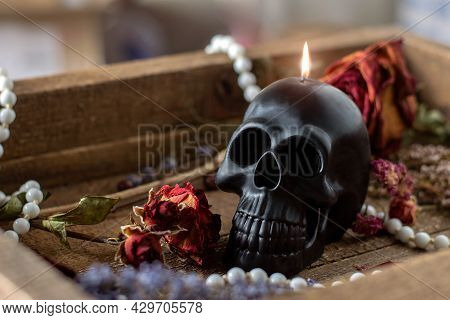 Black Candle Scull On Witch Table. Occult, Esoteric, Divination And Wicca Concept. Halloween, Day Of