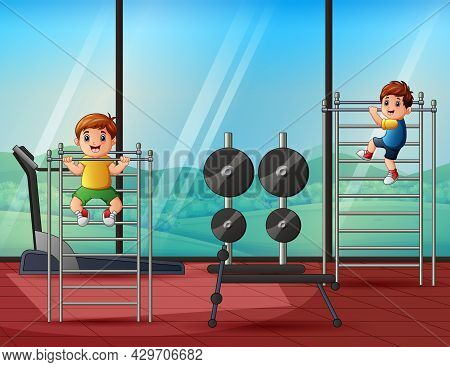 Cheerful Little Boys Pulling Himself Up On A Sport Horizontal Bar In A Gym