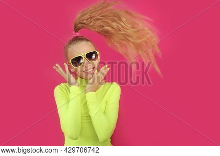 A Beautiful Cheerful Girl In Sunglasses On A Colored Background