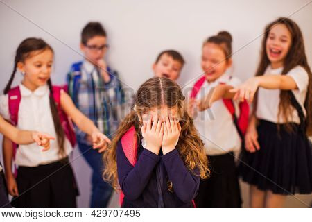 The Classmates Point To The Boy And Laugh At Him
