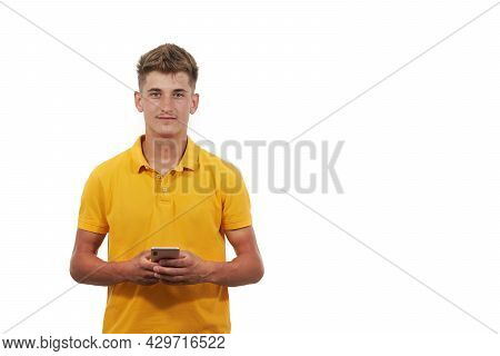 Portrait Of Handsome Man Dressed Casual In Blue T-shirt. Using The Smart Phone
