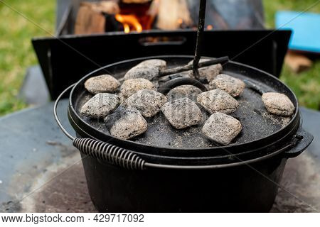 Dutch Oven Camp Cooking With Coal Briquettes Beads On Top. Campfirecamping Life