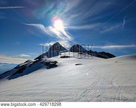 Ski Tour On The Clariden Mountain, Ski Mountaineering With A Big Panorama Mountains. Sunrise Glarus