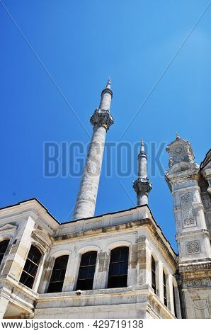 View Of Two Minarets And A Mosque. High Minarets Against The Blue Sky. Old Mosque In Istanbul.