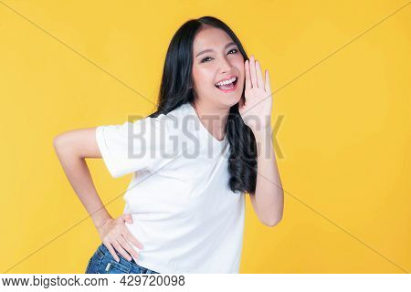 Beautiful Asian Young Woman Screams Announce The Good News Or Promotion , Holding Hands Near Her Fac