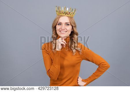 Portrait Of Glory. Smiling Blonde Woman In Crown. Self Confident Queen. Expressing Smug