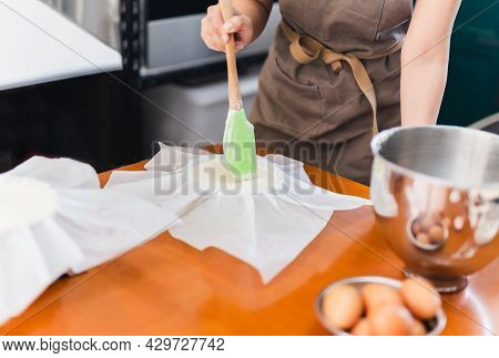 Woman Beaker Preparing Cake Mix Dough In Form For Baking Tin.