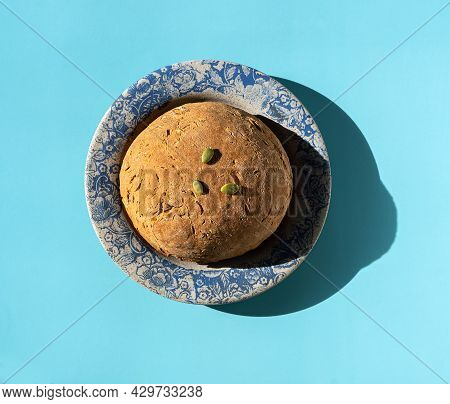 Wheat-rye Bread With Pumpkin Seeds On A Ceramic Plate With A Pattern On The Edge. Healthy Food, Yeas