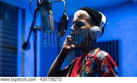 Young Female Singer Recording A New Song Album Inside Music Production Studio