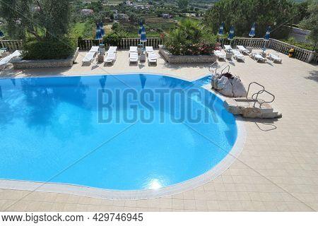 Gargano, Italy - June 6, 2017: Generic Hotel Pool At Gargano Peninsula. Italy Is One Of Most Visited