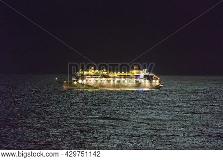 Gulf Of Mexico - April 13, 2020: A Royal Caribbean Cruise Ship Drifting In The Gulf Of Mexico At Nig