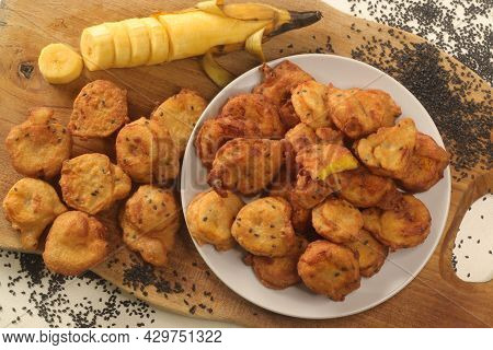 Plantain Fritters. Plantain Slices Dipped In Whole Wheat Flour Batter And Deep Fried In Coconut Oil.