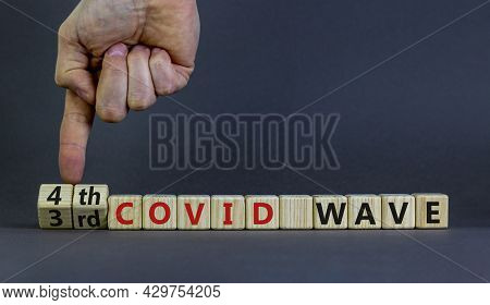 Symbol For A Fourth Wave Of The Covid-19 Corona Virus. Doctors Turns Cubes, Changes Words 3rd Covid