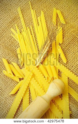 Assortment Of Raw Pasta On A Jute Cloth