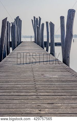 Straight Wooden Bridge With Wooden Posts As Fence Heading To The Atoll, Woldstrand Zeewolde Beach Re