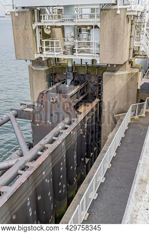 Closeup Of The A Dams Or Sluices, Locks, Dykes, Levees, And Storm Surge Barriers In The Delta Works.