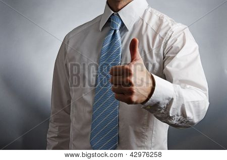 Man wearing tie giving thumbs up
