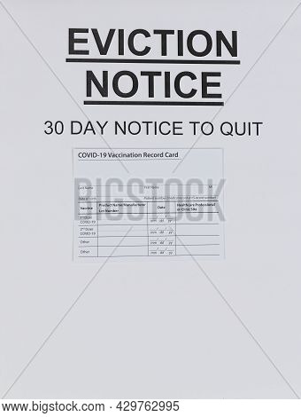 Rental Eviction Legal Notice With Blank Covid 19 Vaccine Card For Eviction Moratorium Concept Of Fin