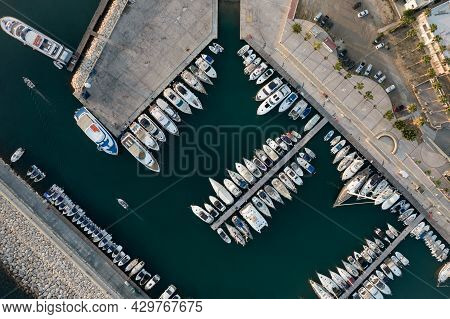 Aerial Drone View Of Fishing Boats And Tourist Yachts Moored At The Marina. Latsi Harbor Paphos Cypr