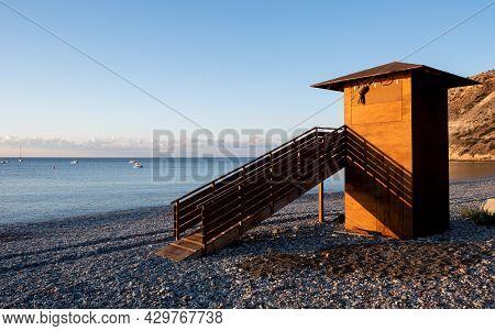 Lifeguard Wooden Station Tower At Sunrise. Empty Beach Pissouri Cyprus