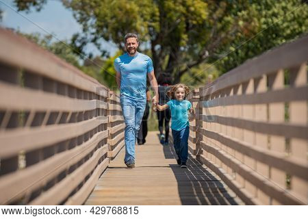 Parent Relax With Little Child Boy. Dad With Kid On Summer Day. Parenting And Fatherhood.