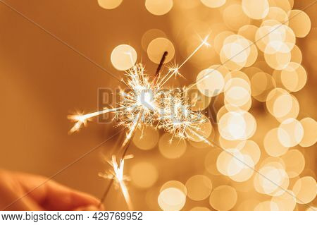 Warm Lights As Abstract Bokeh Made From Christmas Lights With Sparkling Sparkler. Holiday Concept, B