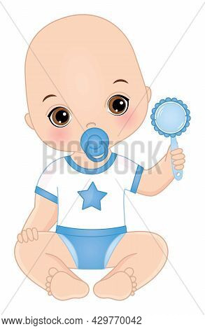 Cute Little Baby Boy Wearing Blue And White Outfit, Sitting And Holding Rattle. Baby Boy Is Bald Wit
