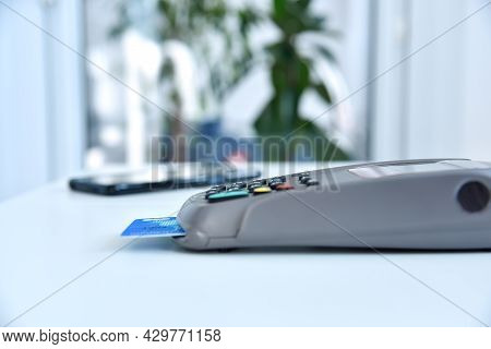 Payment Terminal With Credit Card On Table. Payment With Credit Card On Pos Terminal. Close Up