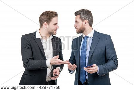 Live Communication. Two Colleagues Discussing Business Hold Phone. Businessmen Business Conversation