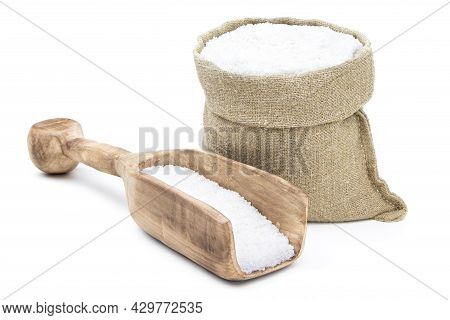 Salt In A Sack Isolated On A White Background. Salt . Salt In A Burlap Sack. Salt In A Jute Bag
