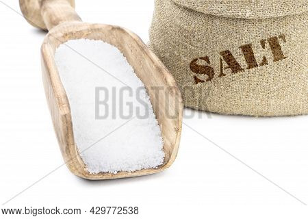 Salt In A Sack Isolated On A White Background. Salt . Salt In A Wooden Scoop. Salt In A Jute Bag.