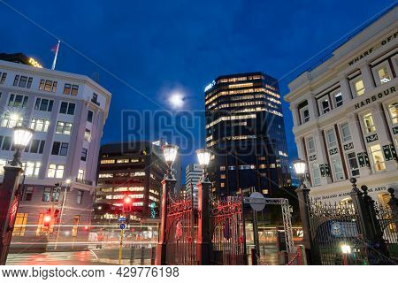 Wellington New Zealand _ July 27 2021;illuminated City Commercial Skyline And Light Streams From Pas